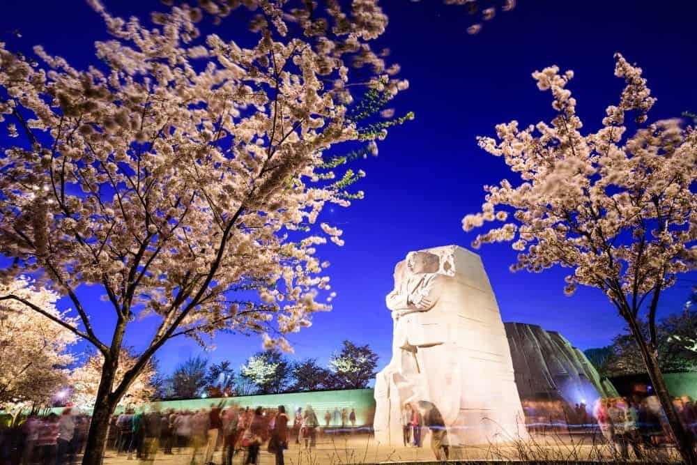 Washington DC, USA - April 12, 2015: Tourists gather under the Martin Luther King, Jr. Memorial in West Potomac Park. MLK Jr. is considered the most prominent leader in the African-American Civil Rights Movement.