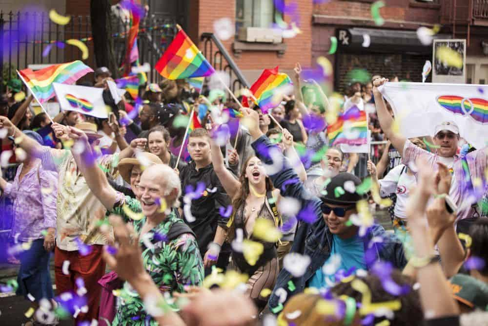New York, USA - June 28, 2015: Participants at the Gay Pride Parade in Greenwich Village. Two days after the Supreme Court ruling that the right to same-sex marriage is guaranteed by the Constitution, the New York City Pride Parade which passes by the site where a police raid in 1969 launched the modern Gay Rights Movement carried with it a sense of triumph.